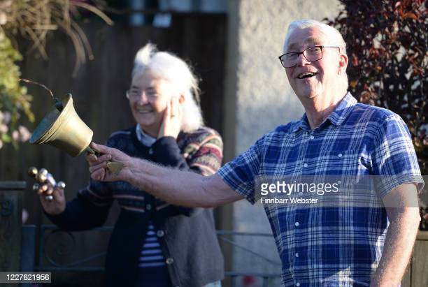 Members of the public ring bells at the entrance of Dorset County Hospital on May 28, 2020 in Dorchester, United Kingdom. For 10 weeks, the public...