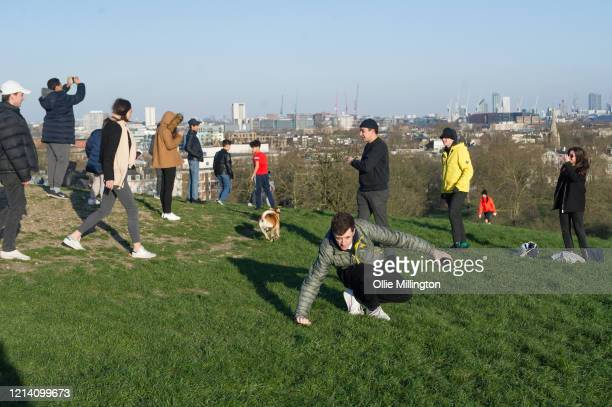 Members of the public seen congregating with friends on Primrose Hill on March 22 2020 in London England Coronavirus has spread to at least 188...