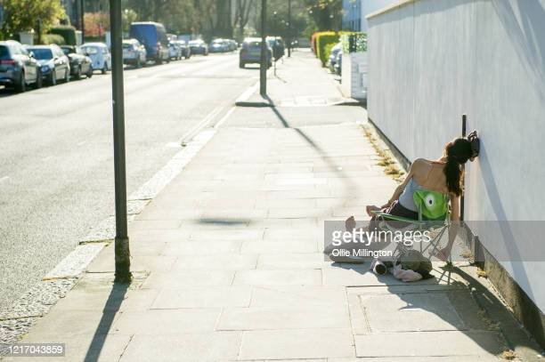 A members of the public seen sunbathing in the street around the corner from Primrose Hill on April 5 2020 in London England The British government...