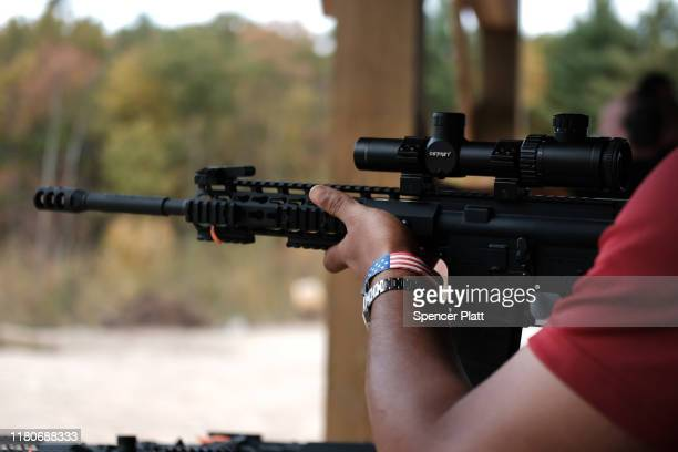 """Members of the public shoot AR15 rifles and other weapons at a shooting range during the """"Rod of Iron Freedom Festival"""" on October 12 2019 in Greeley..."""
