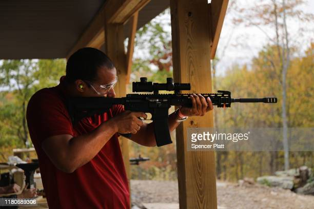 "Members of the public shoot AR-15 rifles and other weapons at a shooting range during the ""Rod of Iron Freedom Festival"" on October 12, 2019 in..."