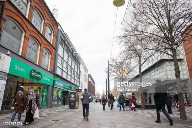 Members of the public shop for essentials on 26th November 2020 in Slough, United Kingdom. The UK government has announced that Slough will move into...