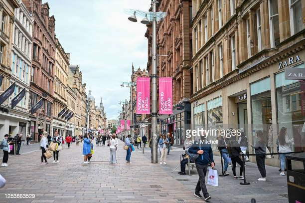 Members of the public shop in Buchanan Street on July 2, 2020 in Glasgow, Scotland. The use of face coverings will become mandatory in shops in...