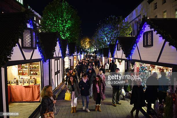 Members of the public shopping in the 'St Nicholas Fair' Christmas market in the city centre of York Northern England on December 3 2014 AFP PHOTO /...