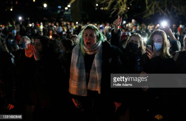 Members of the public shout during a vigil for Sarah Everard on Clapham Common on March 13, 2021 in London, United Kingdom. Vigils are being held...