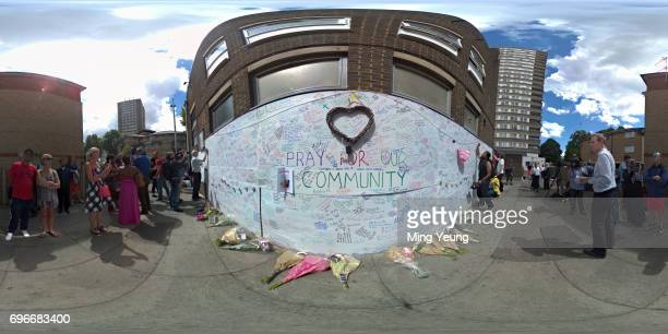 Members of the public sign and reflect on a prayer wall at the Latymer centre as the community comes to terms with what happened on June 15 2017 in...