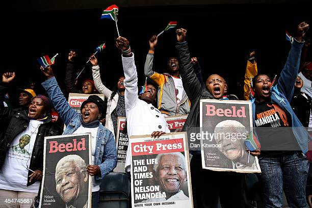 Members of the public sing and dance inside the Orlando Stadium in Soweto, on December 10, 2013 in Johannesburg, South Africa. Over 60 heads of state...