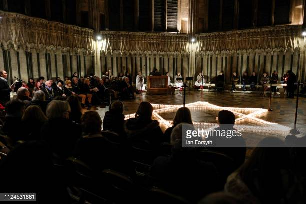 Members of the public sit around the Star of David during a service to commemorate Holocaust Memorial Day in Chapter House at York Minster on January...