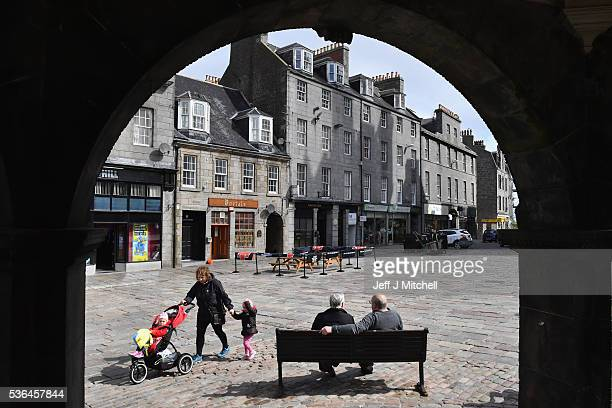 Members of the public sit on a bench in Castle Street on June 1 2016 in Aberdeen Scotland A recent poll showed that Aberdeen is one of the most proEU...