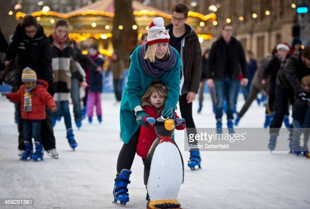Members of the public skate on Christmas eve at the ice rink infront of the Natural History Museum on December 24 2013 in London England With just 1...