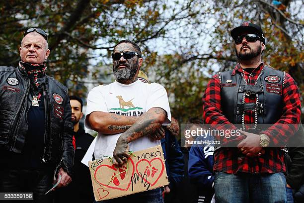 Members of the public stand in silence during a march to bring awareness to child abuse and family violence on May 22 2016 in Auckland New Zealand...
