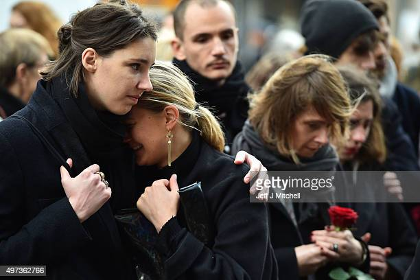 Members of the public stand still at La Belle Equipe cafe on Rue de Charonne, one of the places attacked by terrorists, on November 16, 2015 in...