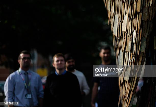 Members of the public stop to look at the Knife Angel sculpture after it is installed in the Centre Square in Middlesbrough on August 06 2019 in...