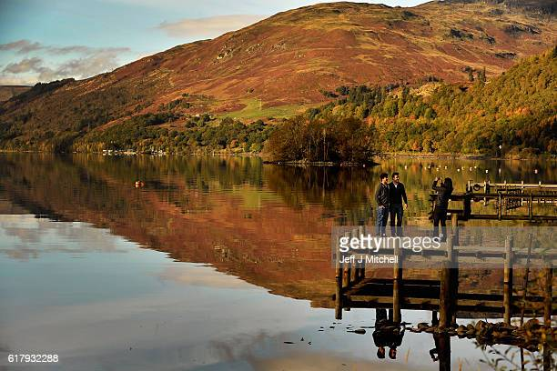 Members of the public stop to view the autumn colours on October 25 2016 in St FillansScotland After an unusually warm October and a mild autumn so...