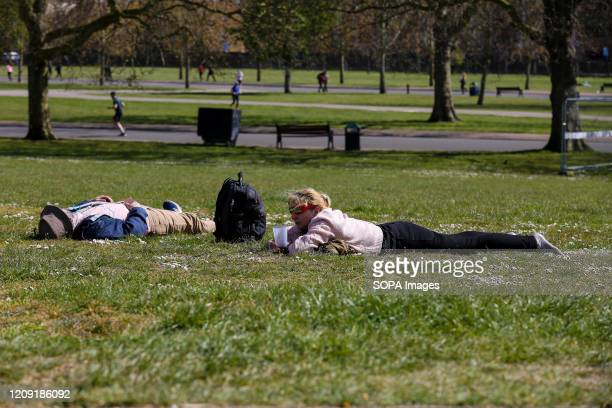 Members of the public sunbathe in Finsbury Park, north London on a warm and sunny day. The Met Office is predicting temperatures in the capital...