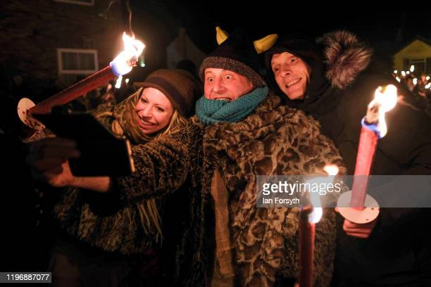 Members of the public take a selfie during New Year's Eve celebrations at the Flamborough Fire Festival on December 31 2019 in Flamborough England...