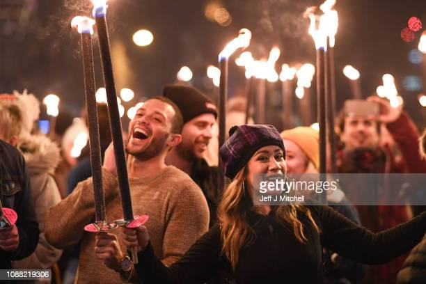 Members of the public take part during the torchlight procession as it makes its way down the Royal Mile for the start of the Hogmanay celebrations...