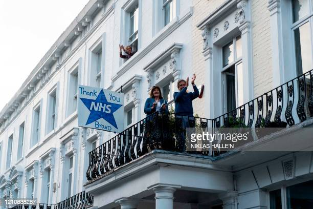 Members of the public take part in a national clap for carers to show thanks for the work of Britain's National Health Service workers and frontline...