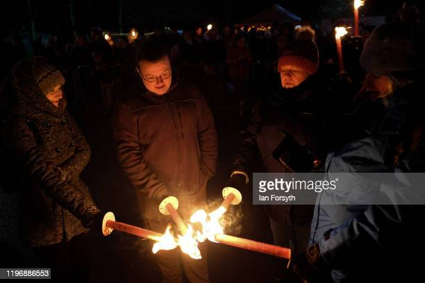 Members of the public take part in a torchlit procession during New Year's Eve celebrations at the Flamborough Fire Festival on December 31 2019 in...