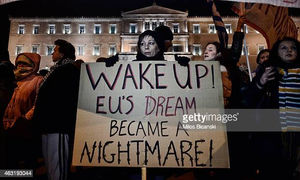Members of the public take part in an antiausterity demonstration in front of the parliament on February 11 2015 in Athens Greece More than ten...