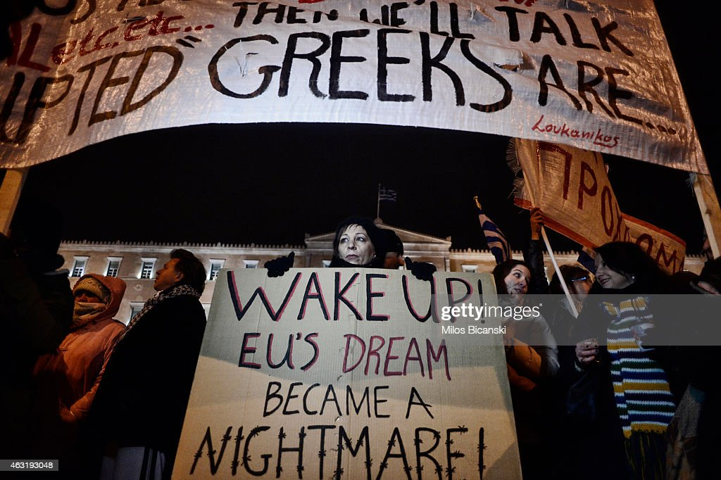 Members of the public take part in an anti-austerity demonstration in front of the parliament on February 11, 2015 in Athens, Greece. More than ten thousand people took to the streets of Athens in support of their new government, who are attempting to re-negotiate the terms of the country's bailout with EU finance ministers.