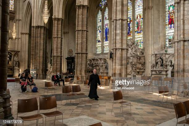 Members of the public take part in private prayer while maintaining social distancing in Westminster Abbey on June 15, 2020 in London, England. The...