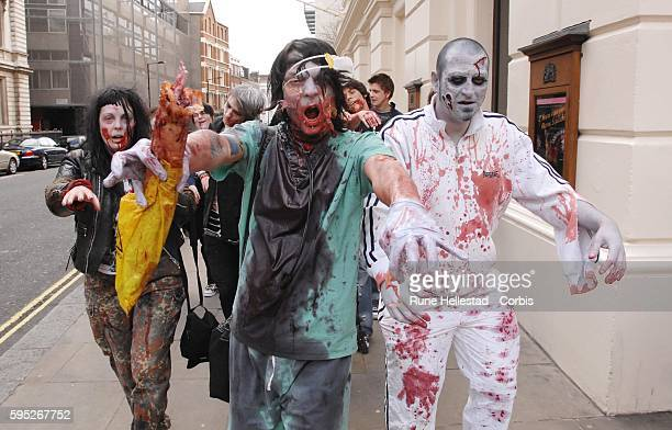 Members of the public take part in the 'Zombie Flash Mob' walk through central London