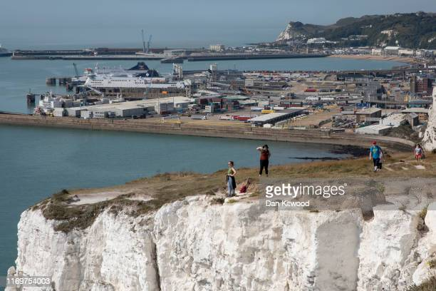 Members of the public take photographs from the top of the white cliffs overlooking Dover Port on August 23 2019 in Dover England Traffic is expected...