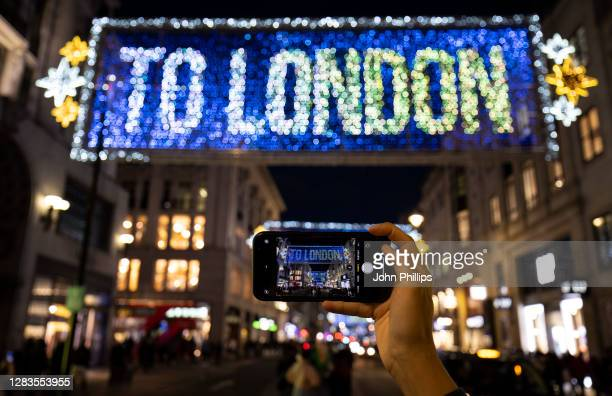 Members of the public take photos during the Oxford Street Christmas Lights Switch-On at Oxford Street on November 02, 2020 in London, England.