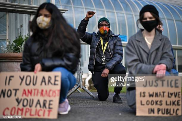Members of the public take the knee in the Botanic Gardens to mark the first anniversary of Georg Floyd's death on May 25, 2021 in Glasgow, Scotland....