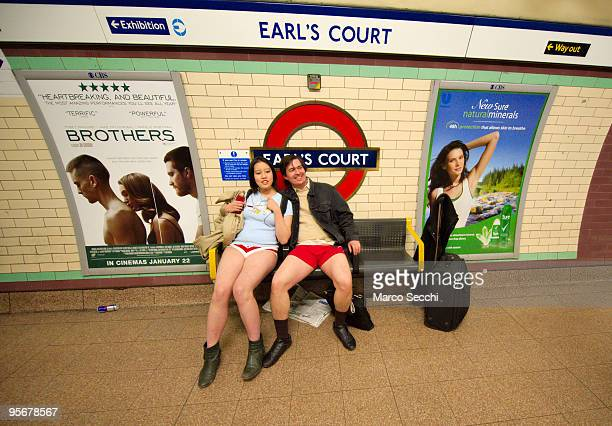 "Members of the public travelling on the London underground take part in ""No Trousers on the Tube"" on January 10, 2010 in London, England. 'No..."