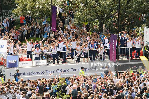 Members of the public turn out in force to show support for the British athletes during the parade of Team GB's Olympic and Paralympic athletes on...