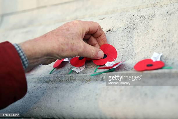 Members of the public Veterans and Armed Services place poppies on the cenotaph after the ANZAC Day Dawn Service at the Auckland Museum on April 25...