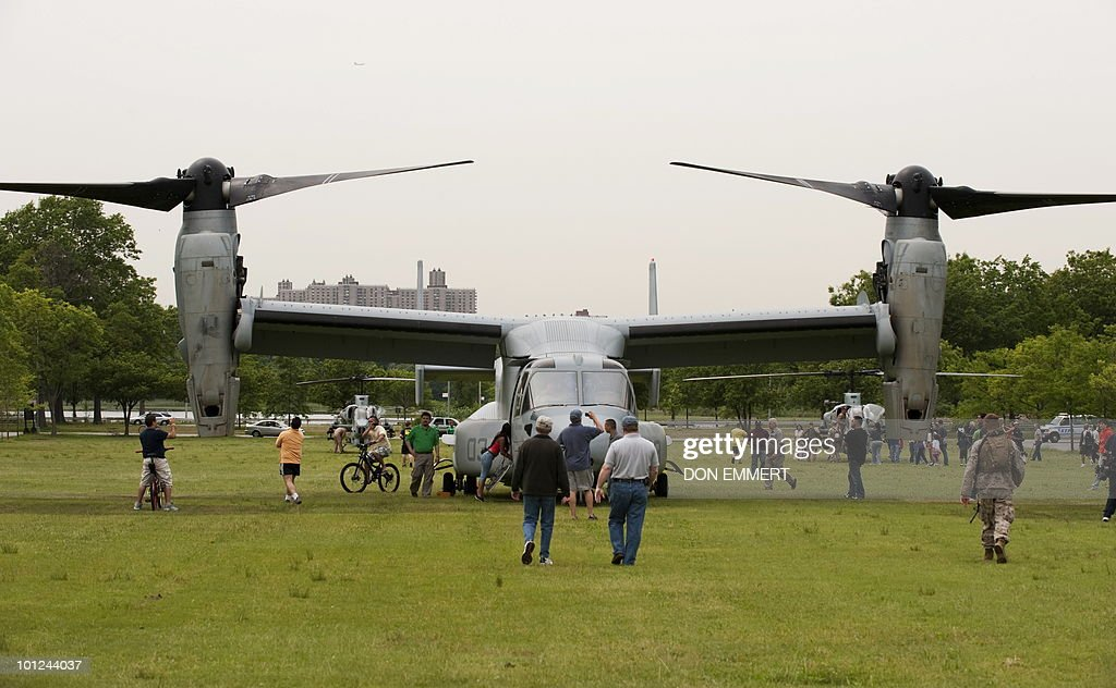 Members of the public view a MV-22 Osprey as the US Marines conduct a public helicopter demonstration May 28, 2010 at Orchard Beach, Bronx, NY. The event was one of many held this week as New York City celebrates Fleet Week.