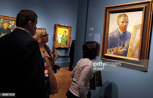 Members of the public view a selfportrait painting by the acclaimed Dutch artist Vincent Van Gogh at the press viewing of an exhibition of his work...