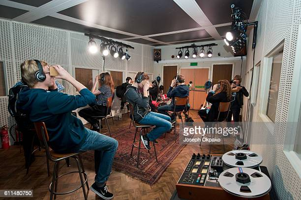Members of the public view a Virtual Reality video which offers viewers a tour of the famous Abbey Road recording studios using the Google Cardboard...