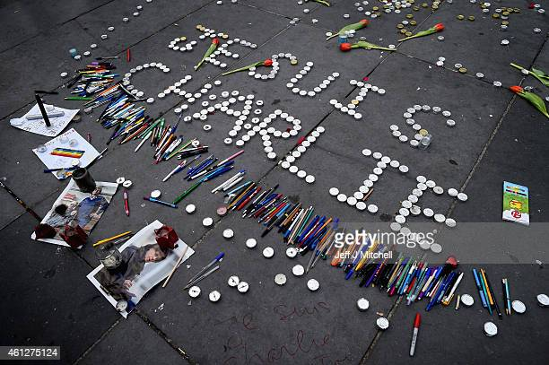 Members of the public view leave pens and candles spelling 'Je Suis Charlie' in tribute at the Place de la Republique on January 10 2015 in Paris...