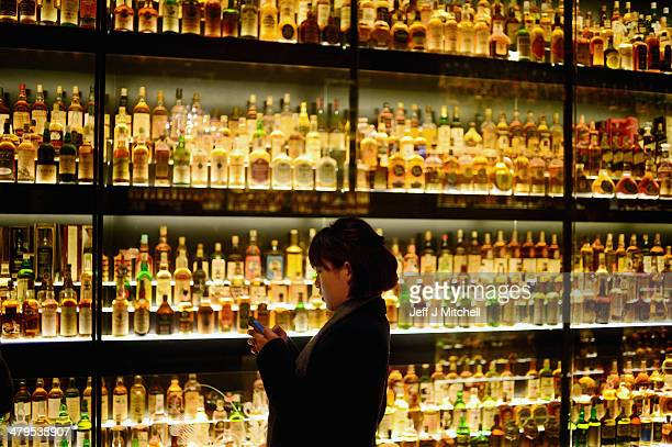 Members of the public view the Diageo Claive Vidiz Collection the world's largest collection of Scottish Whisky on display at The Scotch Whisky...