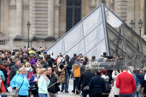 Members of the public visit The Louvre where Emmanuel Macron will celebrate later should he win the French election on May 7 2017 in Paris France...