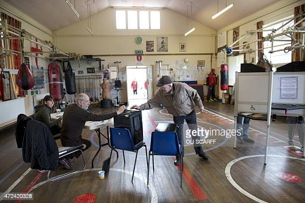 Members of the public vote at East Hull Amateur Boxing Club which is being used as a polling station in Hull Northern England on May 7 2015 as...