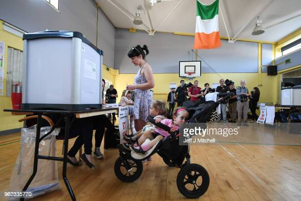 Members of the public vote in Irelands abortion referendum at Scoil Thomas Lodge polling station on May 25 2018 in Dublin Ireland Polling stations...