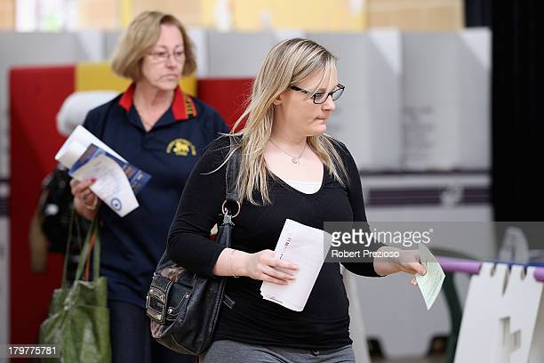 Members of the public vote in the electorate of Sturt on election day on September 7 2013 in Adelaide Australia Voters head to the polls today to...