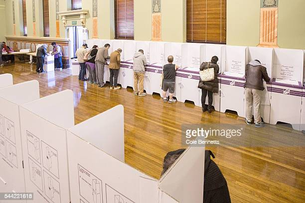 Members of the public vote in the polling booths at the Parramatta Town Hall on July 2 2016 in Parramatta Australia Voters head to the polls today to...