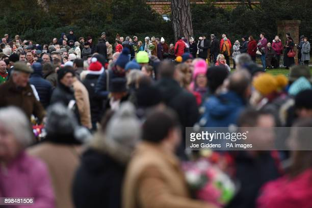Members of the public wait for the Royal family to attend the Christmas Day morning church service at St Mary Magdalene Church in Sandringham Norfolk