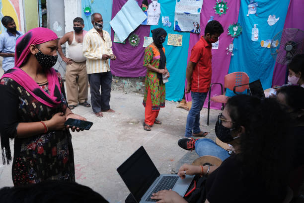 IND: Vaccination Drive for the Poor at Delhi's Sanjay Camp Slum