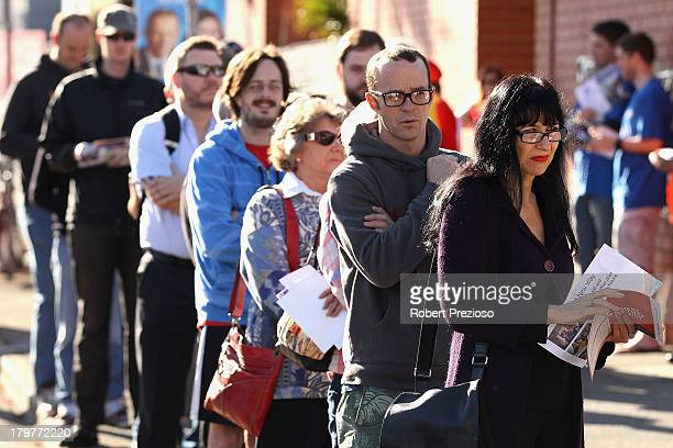 Members of the public wait in line to vote in the electorate of Adelaide South on election day on September 7 2013 in Adelaide Australia Voters head...