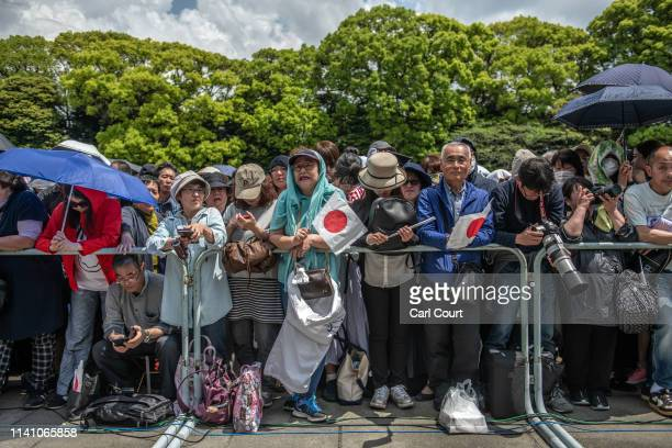 Members of the public wait in the grounds of the Imperial Palace ahead of a public address by Emperor Naruhito of Japan on May 4 2019 in Tokyo Japan...