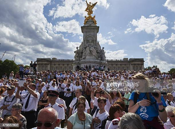 Members of the public wait outside Buckingham Palace to watch a march to celebrate the 150th anniversary of the Salvation Army on July 5 2015 in...