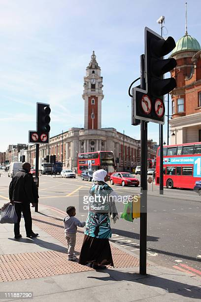 Members of the public wait to cross Brixton Road in central Brixton on April 6 2011 in London England The 1981 Brixton Riot took place 30 years ago...