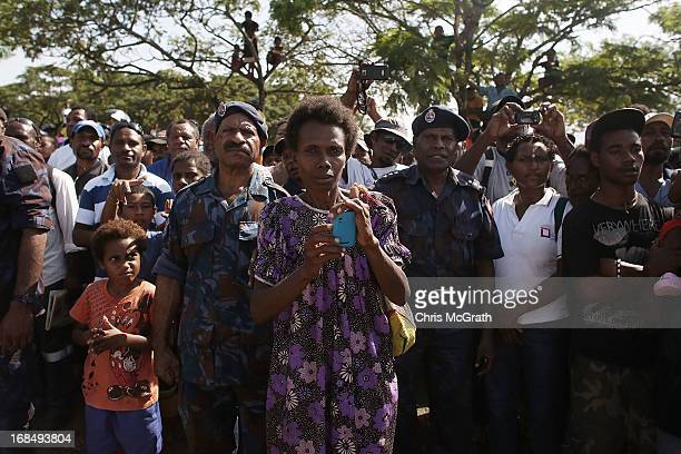 Members of the public wait to see Australian Prime Minister Julia Gillard during her tour of the Gerehu Market on May 10 2013 in Port Moresby Papua...